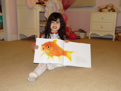 Wordless Wednesday  My daughter and her new favorite book,Curious Critters