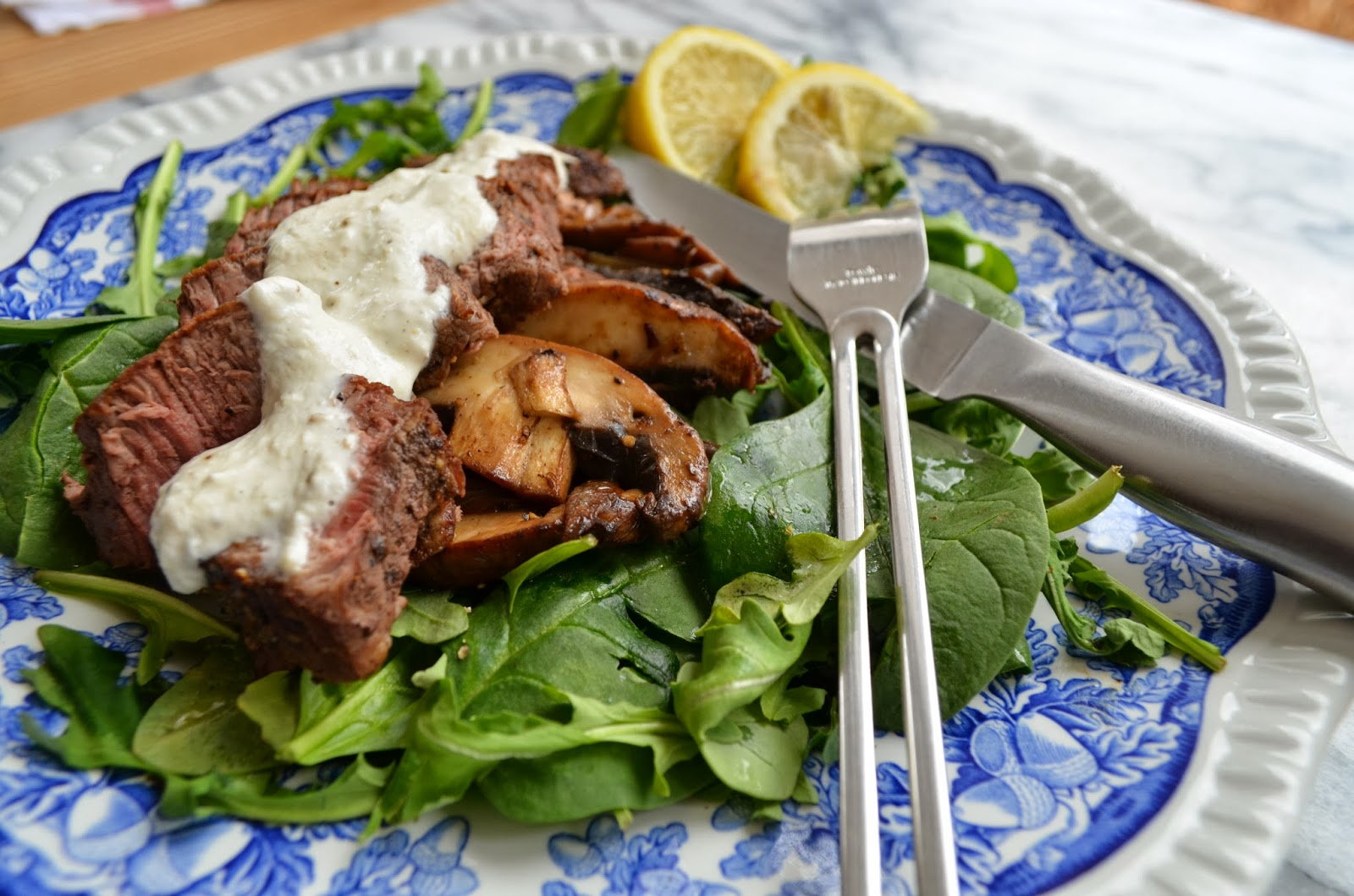 Filet Mignon and Portabella over Fresh Greens - Smell of Rosemary.