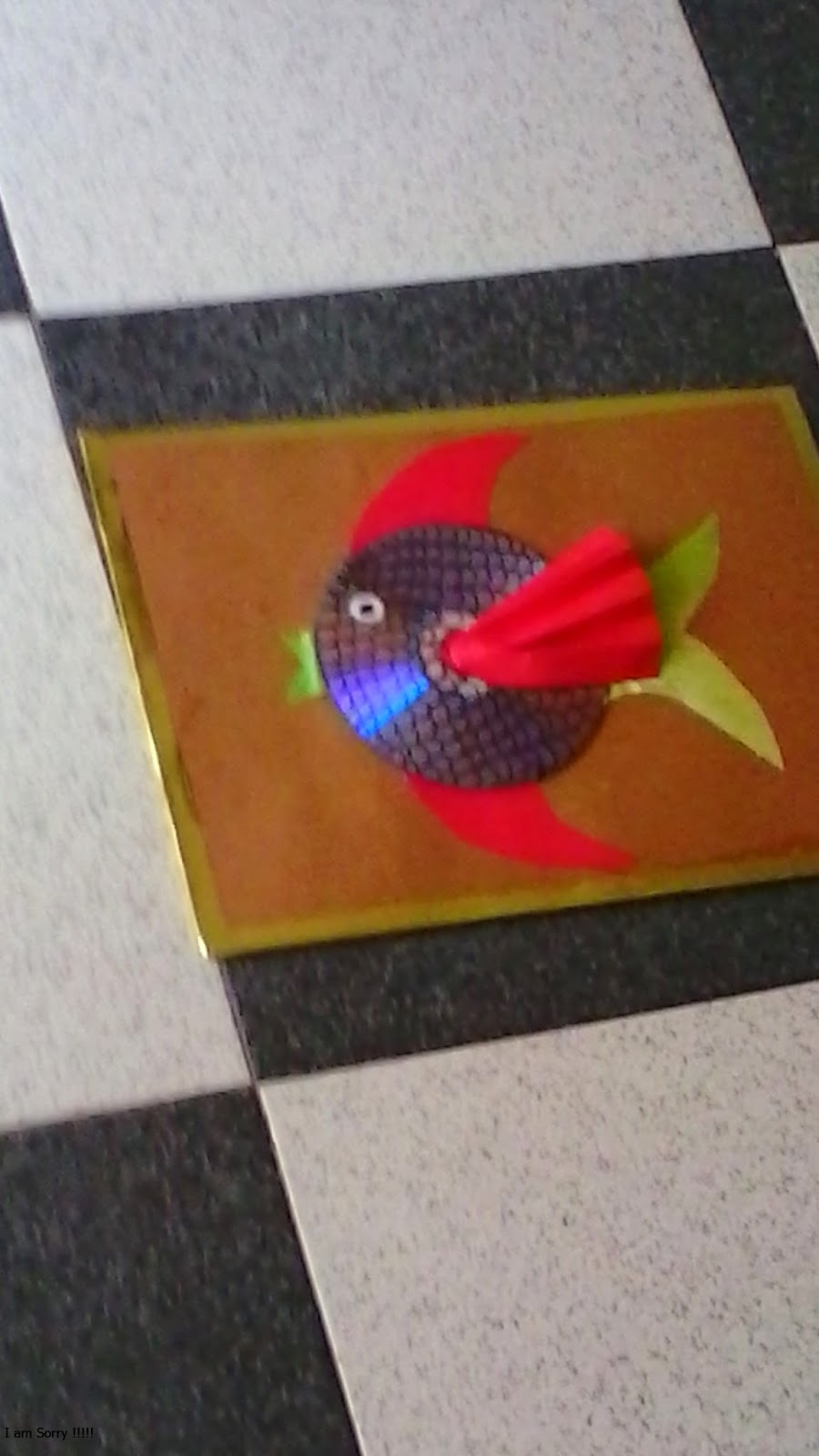 Cuadro con peces hechos con cd o dvd for Cuadros con peces