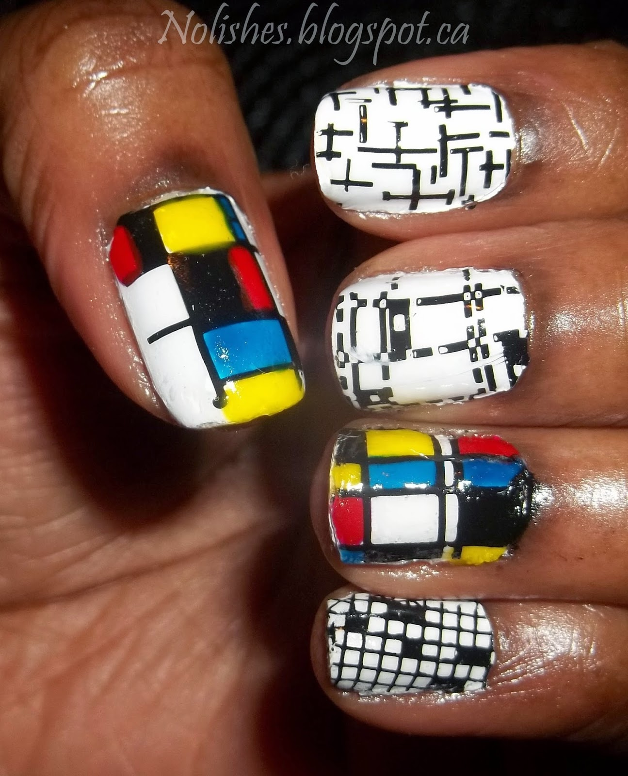 Nail stamping manicure inspired by the artwork or Piet Mondrian. Designed using Moyou London Artist collection plate 16, and white, black, red, blue, and yellow polishes from China Glaze, Essie, Konad, and Nfu Oh.