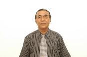 Drs. H. Erwan Kurtubi, M.M.