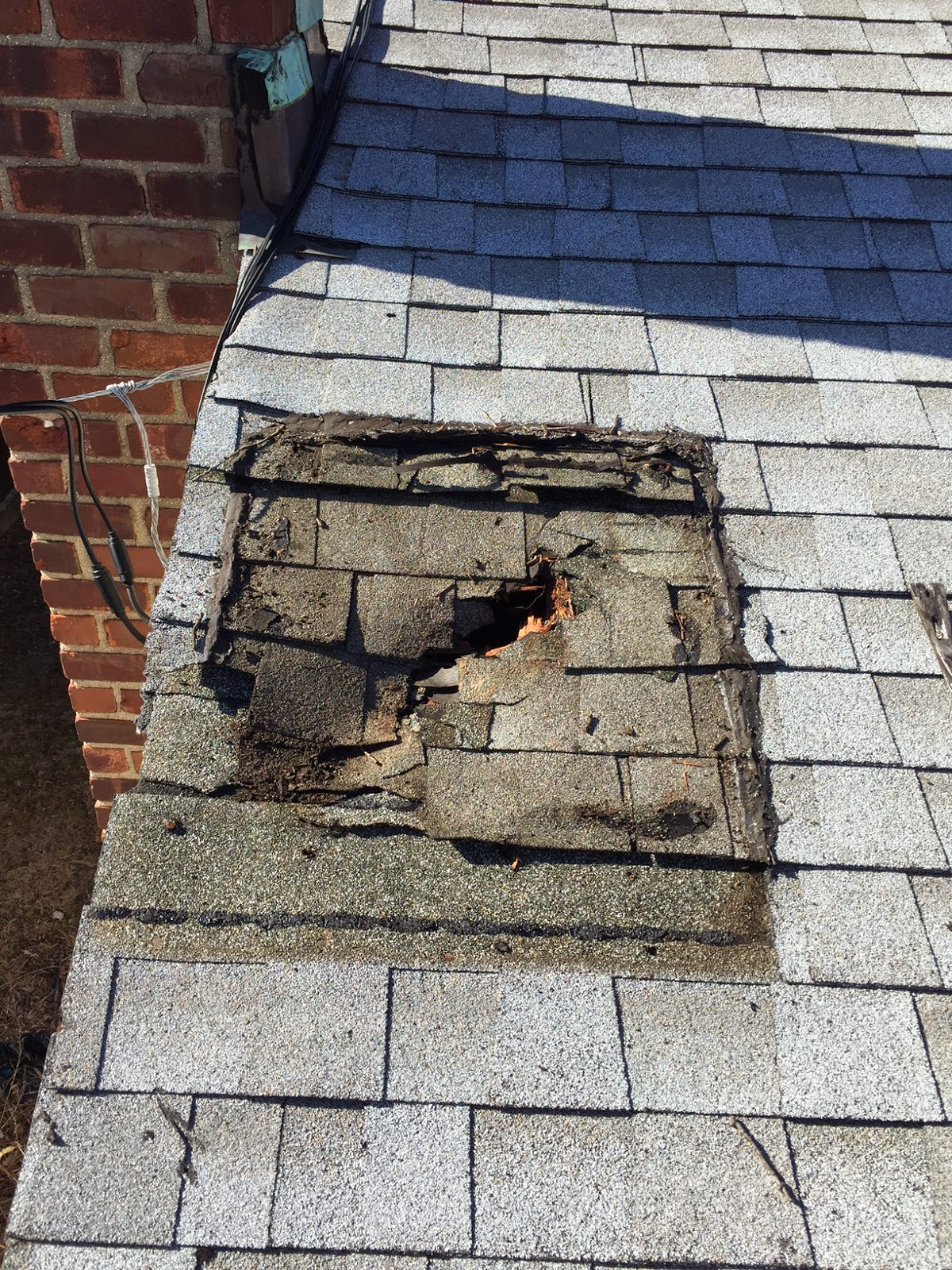 how to fix hole in shingle roof