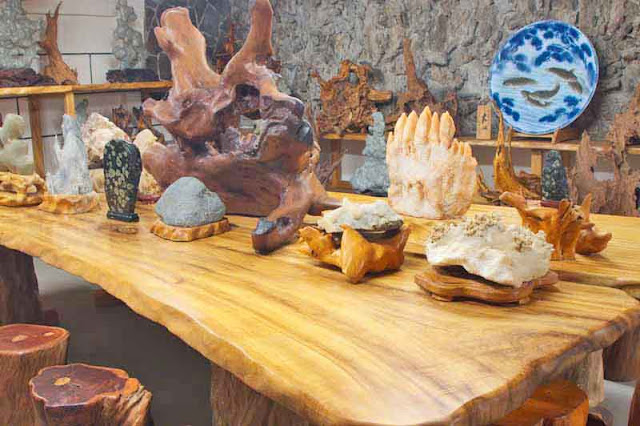 wood table, stone carvings,cave