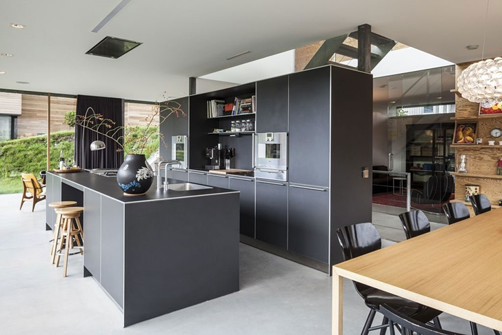 Black kitchen in Modern Villa V by Paul de Ruiter Architects