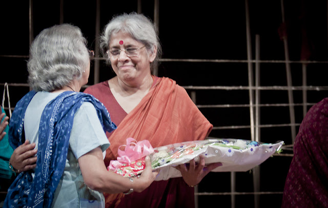 The director Ms. Kirti Jain being presented a bouquet after the completion of the play. The play was very complicated with each scene involving interactions between multiple characters.
