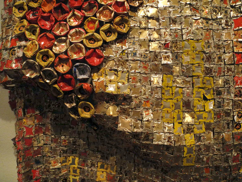 el anatsui inspired artwork Art-rated's jonathan beer writes about gravity and grace: monumental works by el anatsui at the brooklyn museum these draped pieces, made from the flattened tin caps of discarded liquor bottles, were initially inspired by a chance find outside a distillery in nigeria it so happens that these fit an.