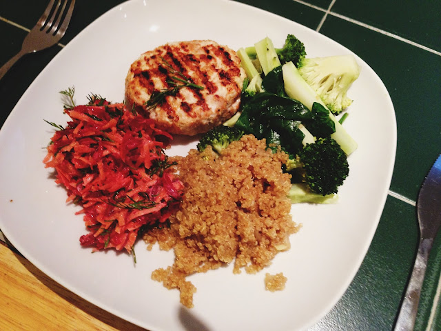 Dish of grilled mince turkey breast, quinoa, greens and beet and carrot salad with dill and mayo.