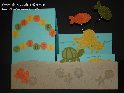 "Blue side stair-step card designed to look like an ocean scene. Light brown card stock stamped with seashells is the sand, and stamped and cut-out turtle, octopus and fish are attached to the ""steps."" Greeting is ""birthday fishes."""