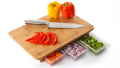 Cutting board with storage container