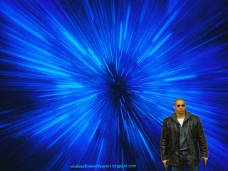 Desktop Wallpaper of Vin Diesel action movie actor with two guns in Blue Vortex Desktop Wallpaper
