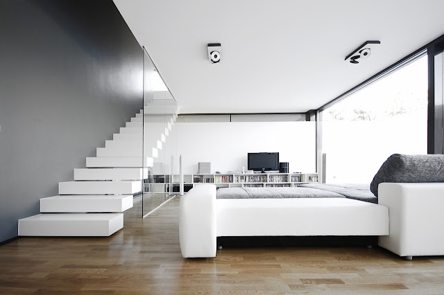 Modern minimal living room in the Black On White House by Parasite Studio