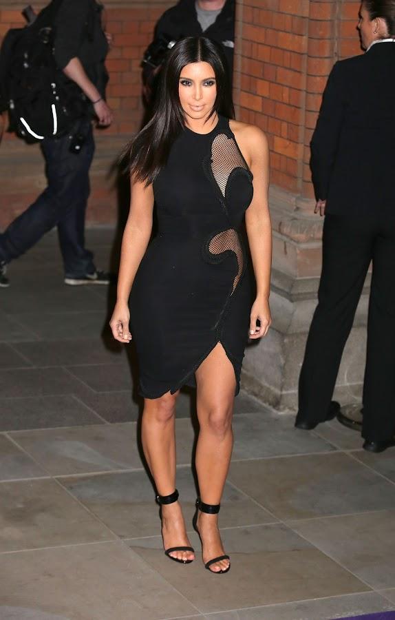 Kim Kardashian posing in a tight black dress