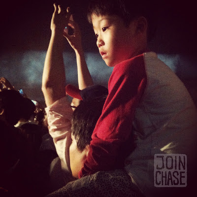 A little Korean boy watching a PSY concert in Cheongju, South Korea.