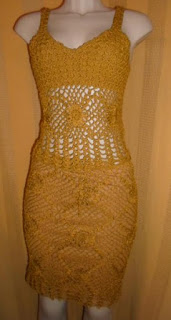 conjunto saia e  blusa  na cor ouro envelhecido em trico