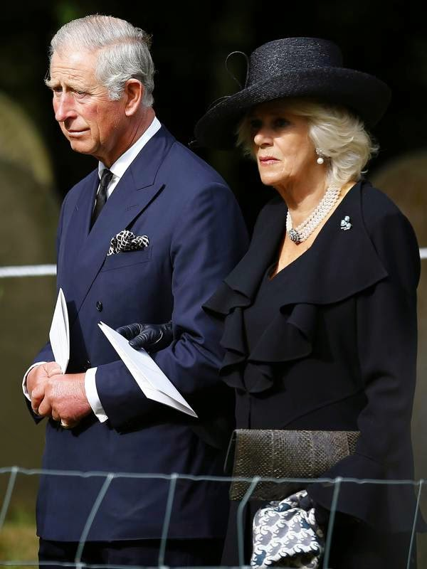 Britain's Prince Charles and Camilla Duchess of Cornwall walk to the burial site of Deborah, Dowager Duchess of Devonshire after the funeral service at St Peter's Church in Edensor, central England, 02.10.2014.
