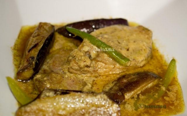 Hilsa fish cooked with butter egg plant and mustard