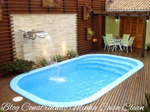 Construindo minha casa clean deck de madeira na parede for Luminarias para piscinas