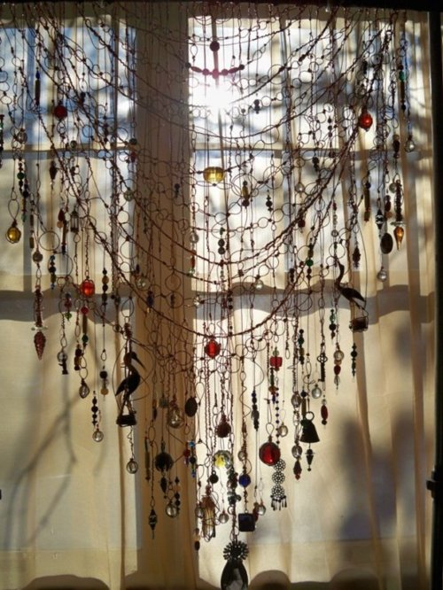 Add a beaded curtain you can make one yourself with some thin wire