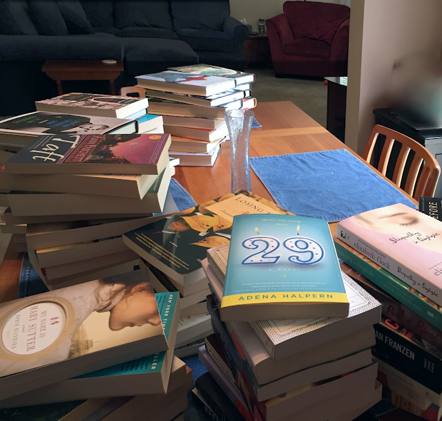 book stacks on the table book purge The 3 Rs Blog
