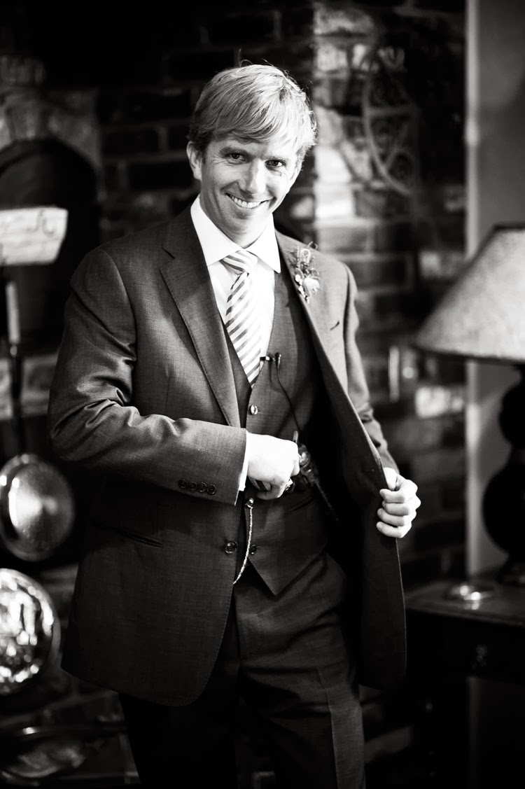 groom holding pistol and laughing