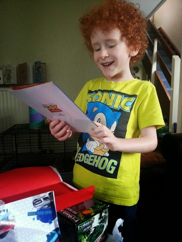 6 year old laughing at birthday card smiling