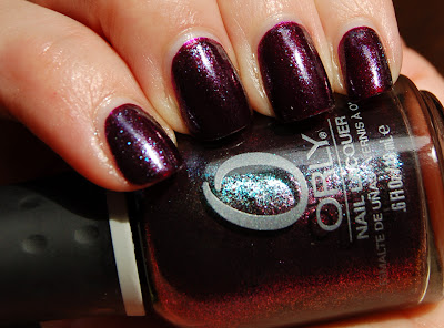 The nail polish Orly Galaxy Girl from the Cosmic FX collection 2010, a purple sparkling nail polish