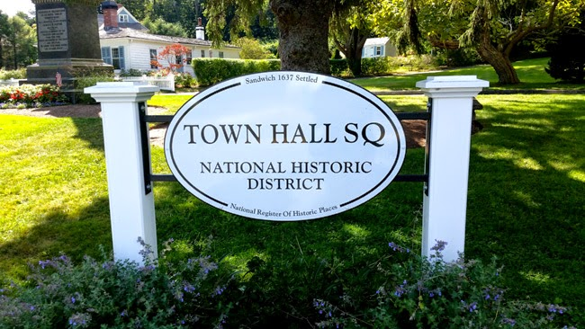 White oval historic marker for Town Hall Square