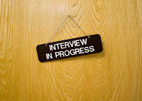 An interview room with interview questions