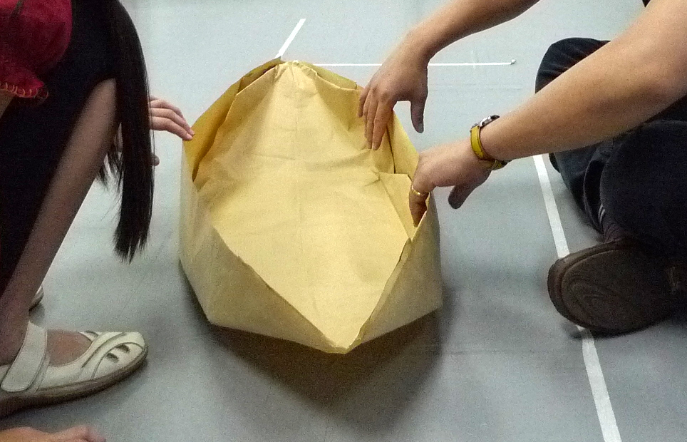 One group made a large paper boat. Each kid had a chance to sit in it ...