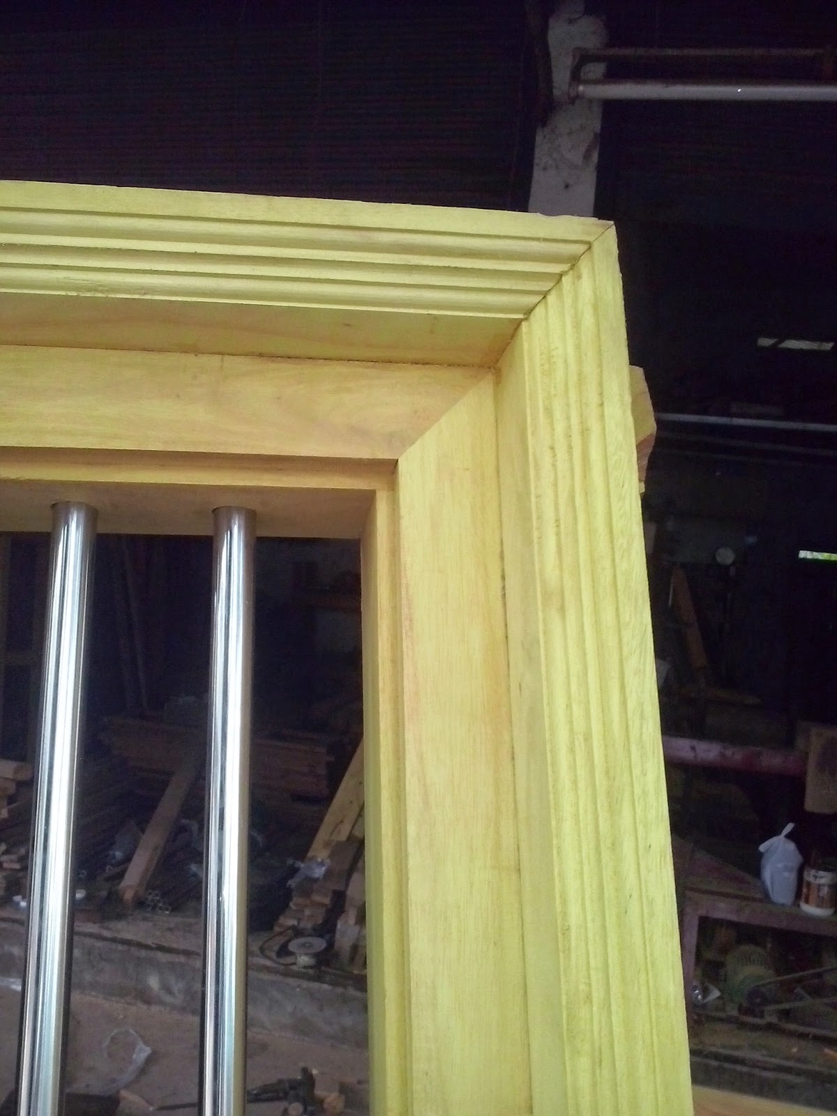 Kerala style carpenter works and designs july 2014 for Window frame design