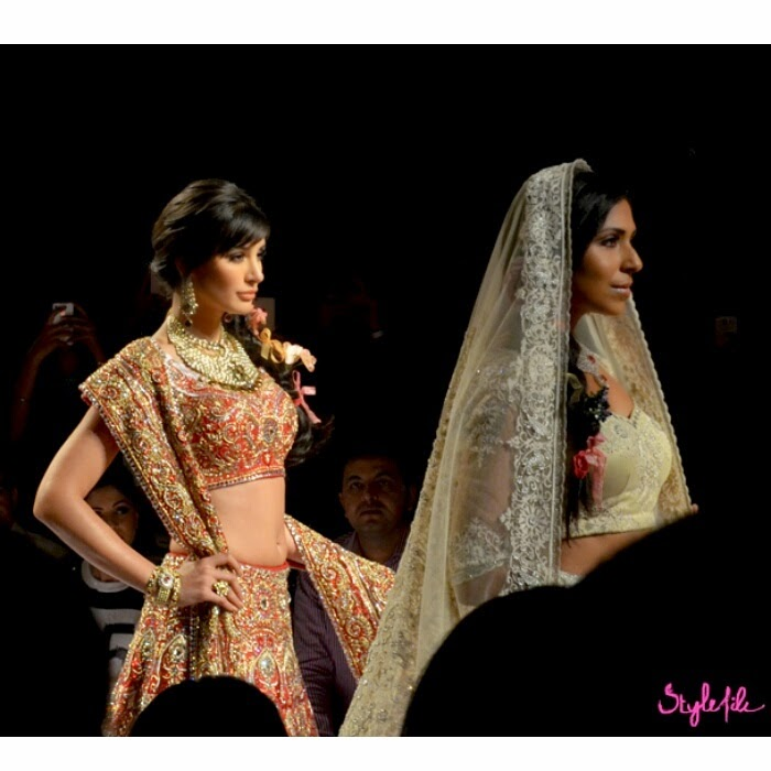 Bollywood actress Nargis Fakhri and model Caron Gracias play showstopper in traditional Indian ethnic wear for Suneet Verma at Lakme Fashion Week