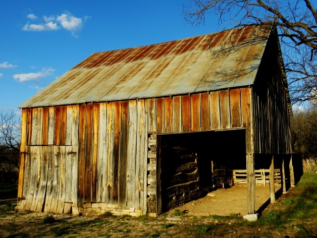 Setting sun on an old barn at South Llano River State Park, Junction, Texas, Monday, March 23, 2015