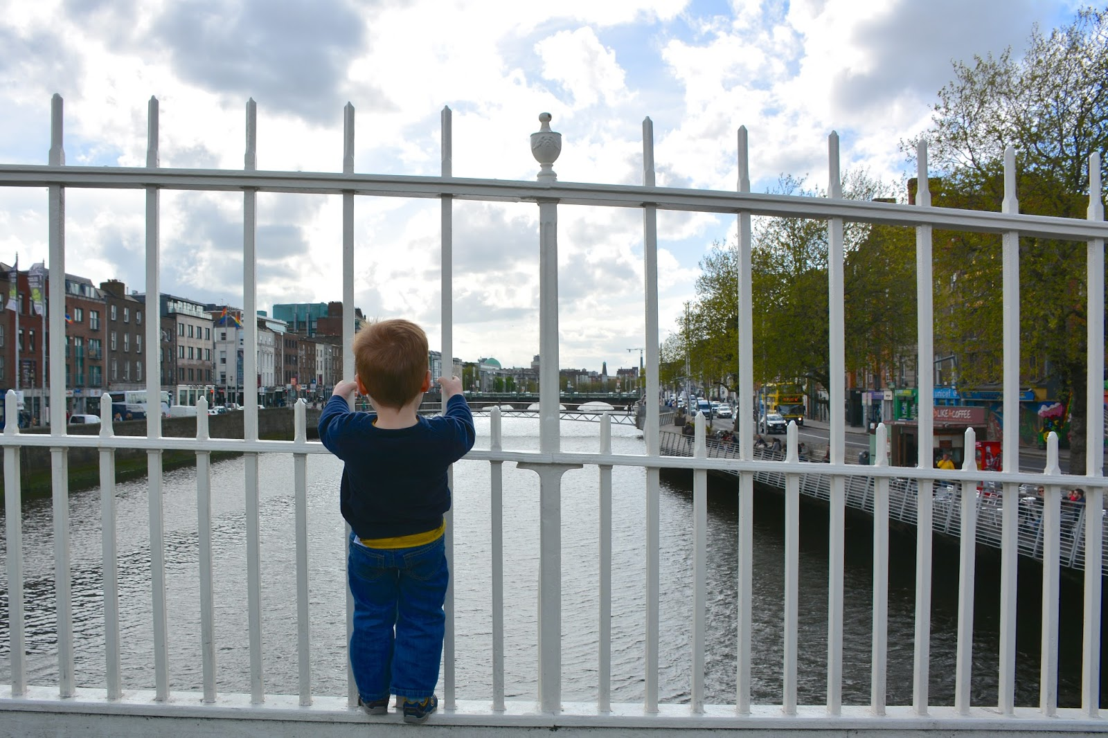 Peering down the River Liffey from the Ha'penny Bridge
