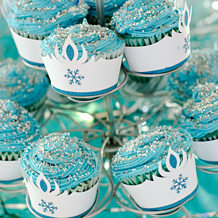 Disney Frozen® inspired birthday party decorations - Blue Velvet cupcakes w/ Blue Raspberry frosting and Ice Queen cupcake wrappers | Silhouette Portrait