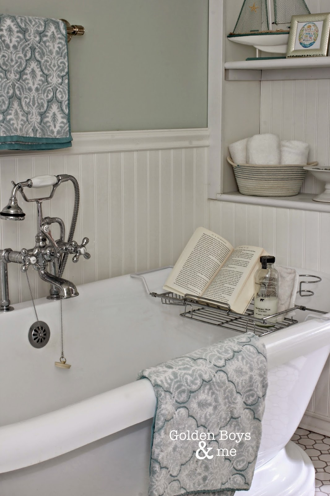 Pedestal tub with vintage style faucet and over the tub rack
