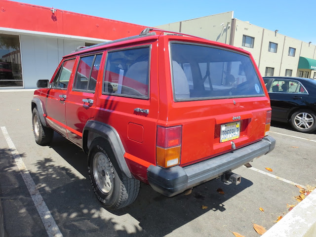 Jeep Cherokee after repairs and paint at Almost Everything Auto Body