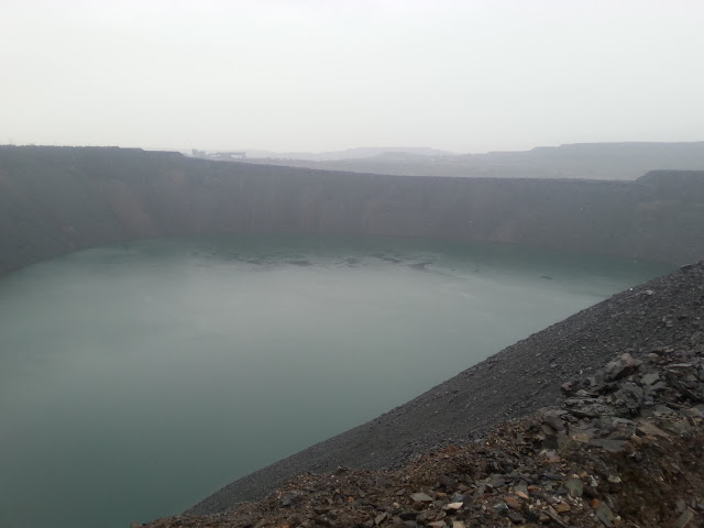 Затопленный и засыпаемый карьер № 1 НКГОКа (АМКР)