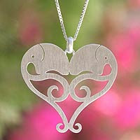 http://jewelry.novica.com/necklaces/pendant/sterling-silver/sterling-silver-heart-necklace-elephant-sweethearts/181816/