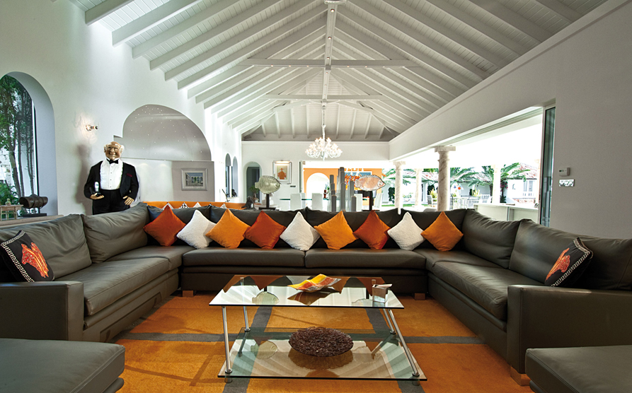 this large sofa is complemented by the small throw pillows and coffee