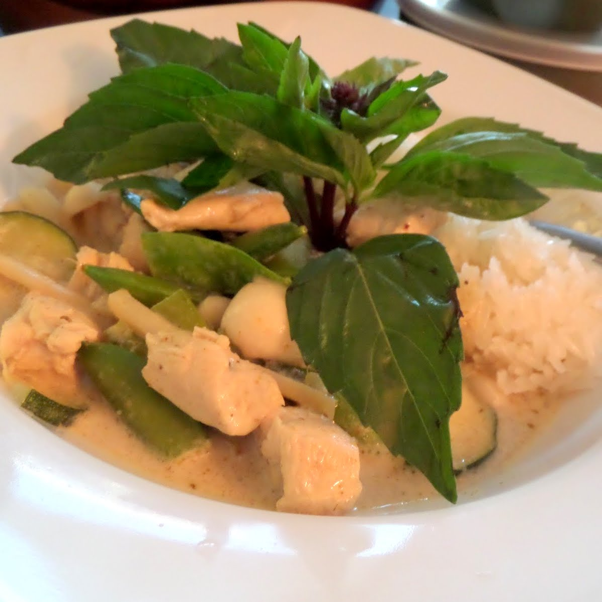 Chicken Green Curry:  a spicy Thai green curry with chicken, veggies, and rice.