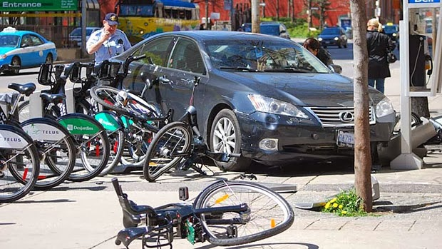 http://www.cbc.ca/news/canada/toronto/car-damages-5-bixi-bikes-1.1033937