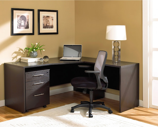 fantastic simple brown wooden corner home office desks close to brown wall with two wall mounted photos along with modern table lamp on top of table and black swivel office chair