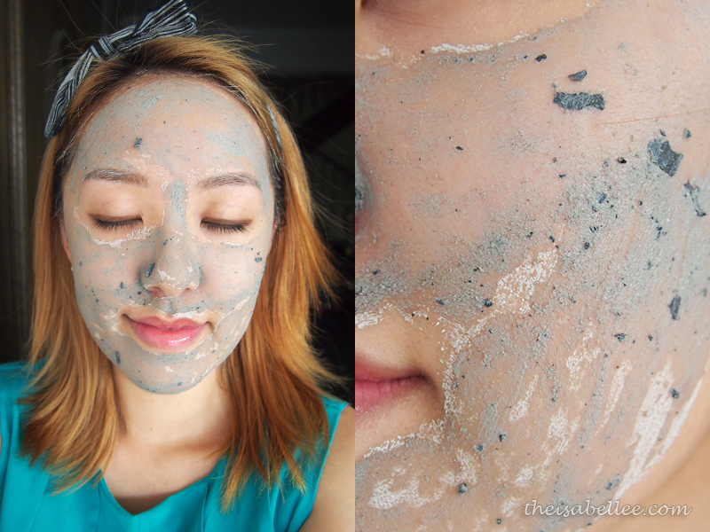 Applying GlamGlow Youthmud Tinglexfoliate Treatment on face