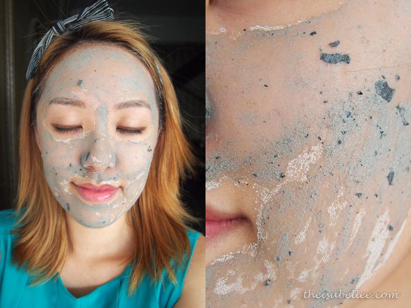 Applying GlamGlow Youthmud Tinglexfoliate Treatment on face