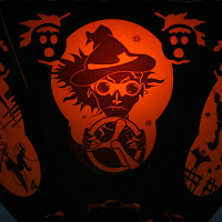 Scifi scene from The Space Witches, a orange & black silhouette Halloween paper lantern by Bindlegrim