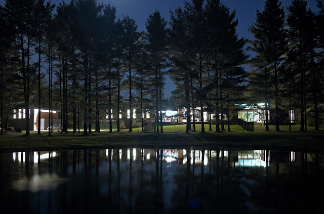 Picture of Clearview Residence by the lake next to the trees as seen at night