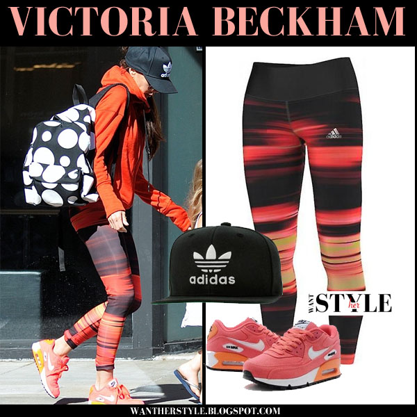 Victoria Beckham in multicolor printed leggings and orange sneakers what she wore workout clothes
