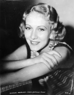 Vintage black and white photo of Karen Morley smiling.