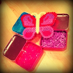 Colour coded hama beads tins