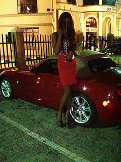 Model Spoils Herself With BMW Convertible Car 1